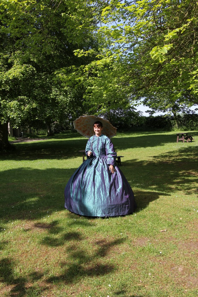 cally-in-victorian-dress-at-la-hougue-bie